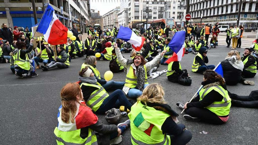 Women wearing a yellow vest (gilet jaune) stage a protest in France (Credit: Jean-Francois Monier/Getty Images)