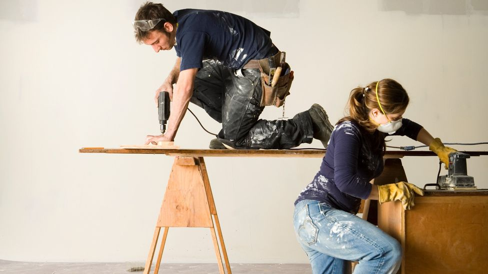 A couple drilling and sanding wood (Credit: Getty Images)