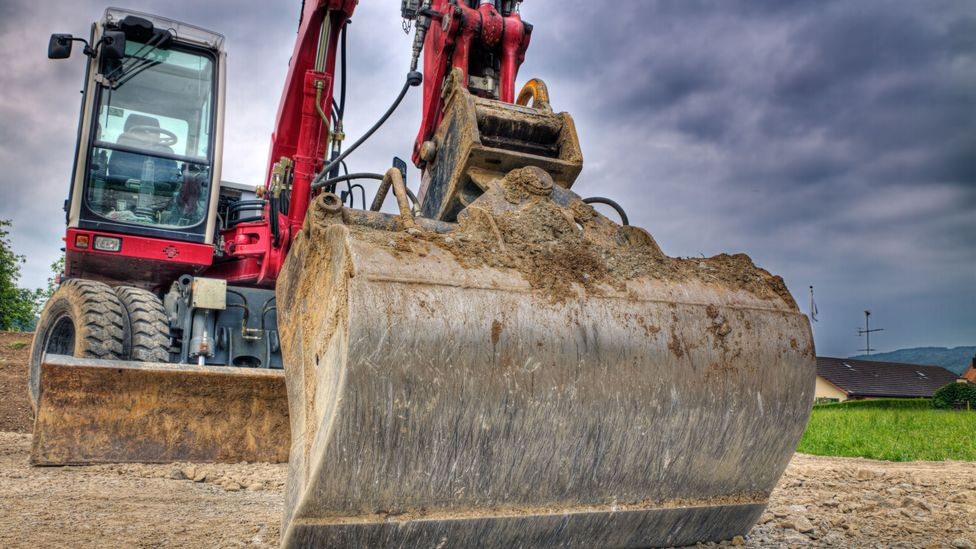 Conventional construction machinery burn through large quantities of fossil fuels for power, but now electric alternatives are carving the way (Credit: Alamy)