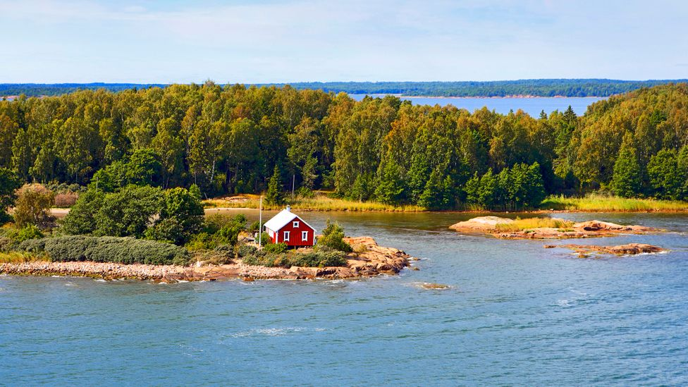 A red fisher's hut on the shore of the Åland Islands, Finland