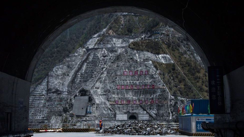 Nature, subsumed: towering walls of concrete entomb forests on mountainsides in south-west China, to build a major dam (Credit: Johannes Eisele/Getty Images)