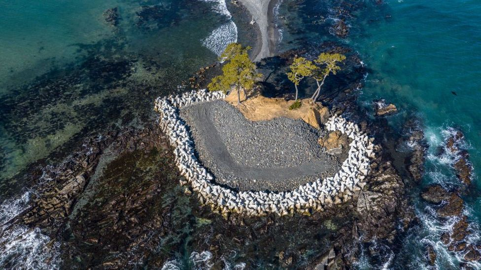 """Concrete """"tetrapods"""" protect a tidal island from the ocean in Kesennuma, Japan (Credit: Carl Court/Getty Images)"""