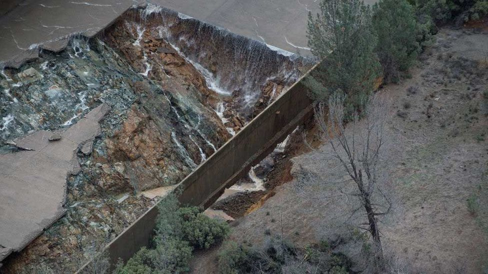 Eroded concrete causes flooding from the Oroville Dam spillway in California (Credit: Kelly M. Grow/Getty Images)