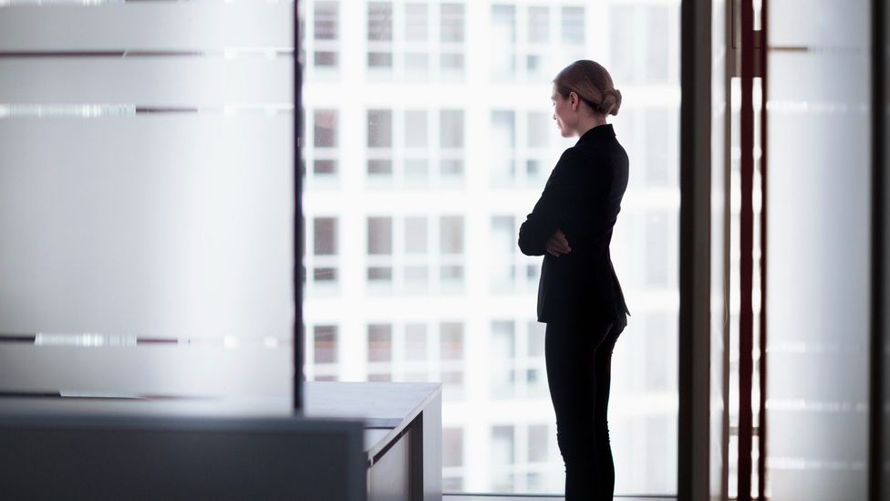 Office worker looking out of a window