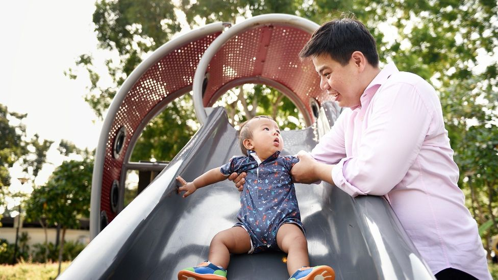 Dads who take time off go on to have closer relationships with their kids, research shows (Credit: Getty)