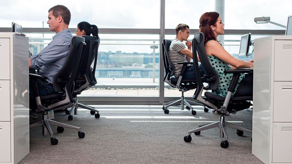 Rather than long lines of desks, hybrid offices should favour collaboration spaces, experts say (Credit: Getty)