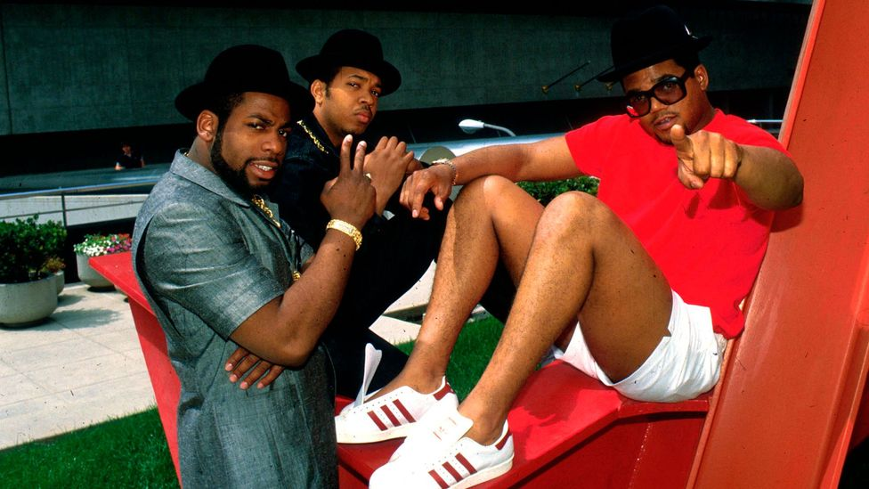 Ever since Run DMC's 1980s hit My Adidas, sneakers have been both style statement and status signifier (Credit: Getty Images)