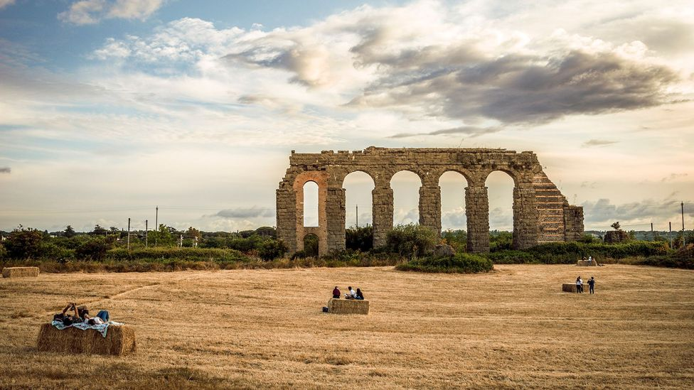 People relaxing near the Aqua Claudia in Rome's Park of the Aqueducts