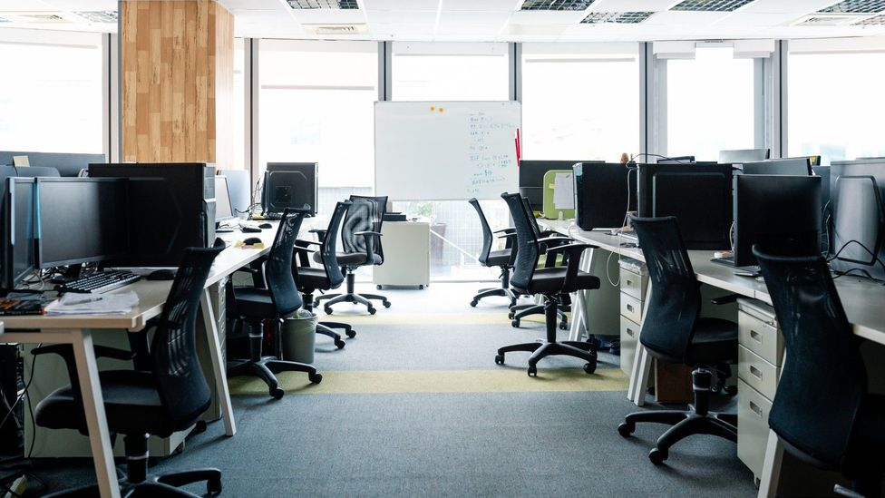 Workdays can be long and tightly controlled - meaning employees are in no hurry to get to their seats early (Credit: Getty)