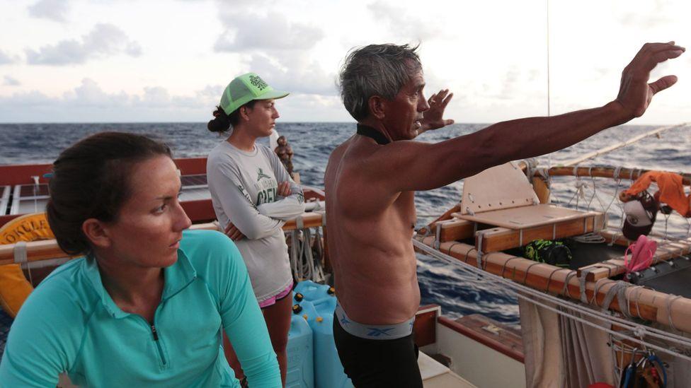 Nainoa Thompson (right) is training a new generation of navigators, including women, who were not historically given master navigator status (Credit: Polynesian Voyaging Society)