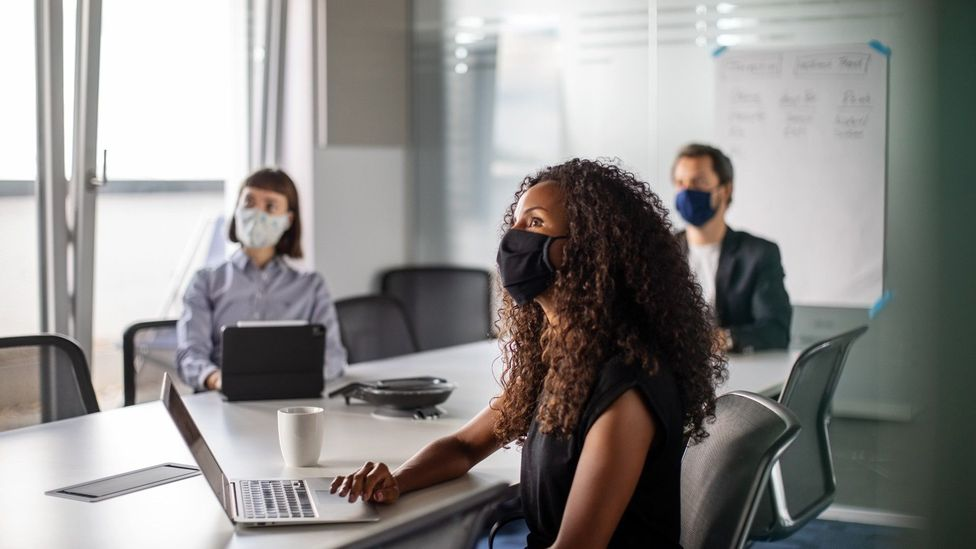 Distancing measures and letting some people work from home can help reduce workplace sickness transmission, experts say (Credit: Getty)