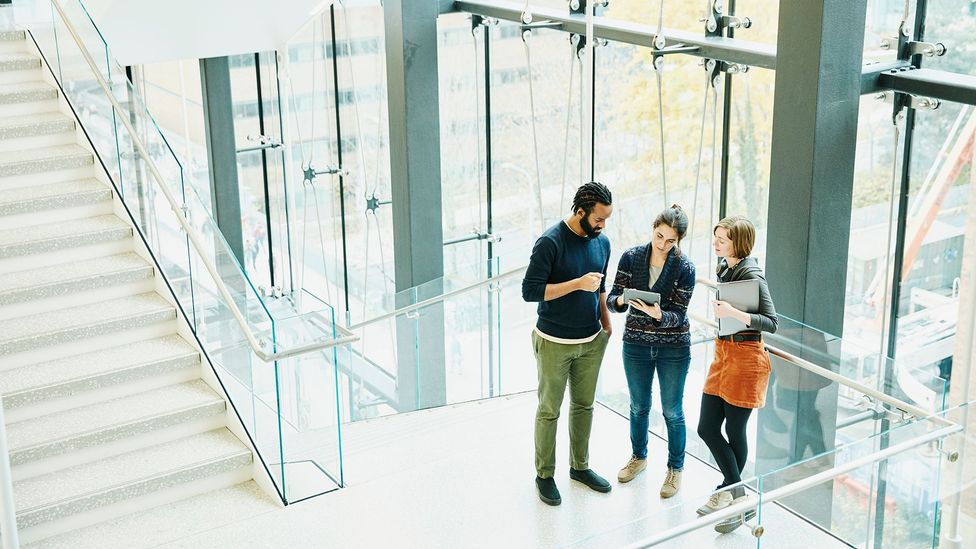 With a hybrid model, the team members who show up in the office may be perceived as harder workers, or build relationships in a way remote workers can't (Credit: Getty Images)