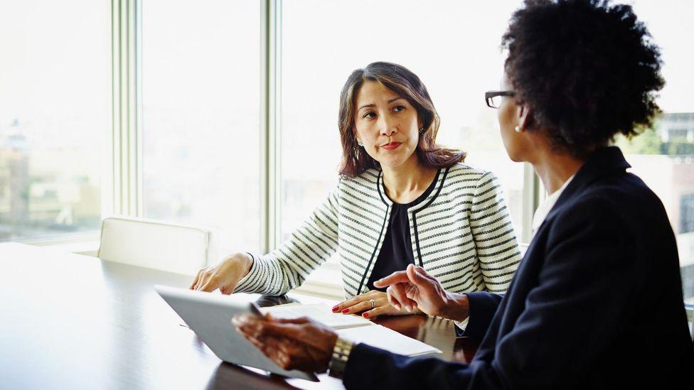 Woman asking her boss for hybrid