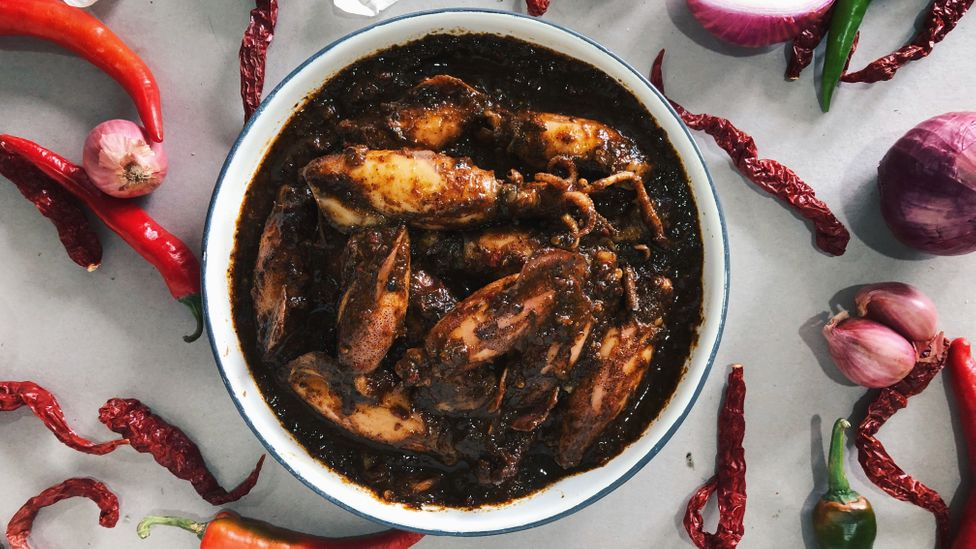 Firdaus Sani serves up traditional dishes like sotong hitam (squid in squid ink) in his food delivery business (Credit: Orang Laut Singapore)