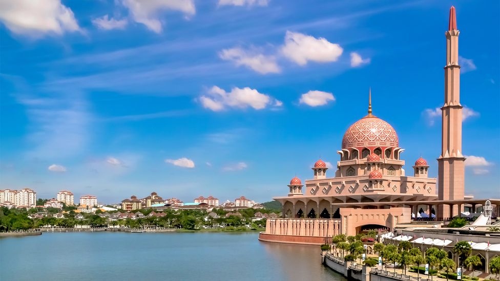 The towering Masjid Putra is one of the only pink mosques in the world (Credit: syahrolrizal/Getty Images)