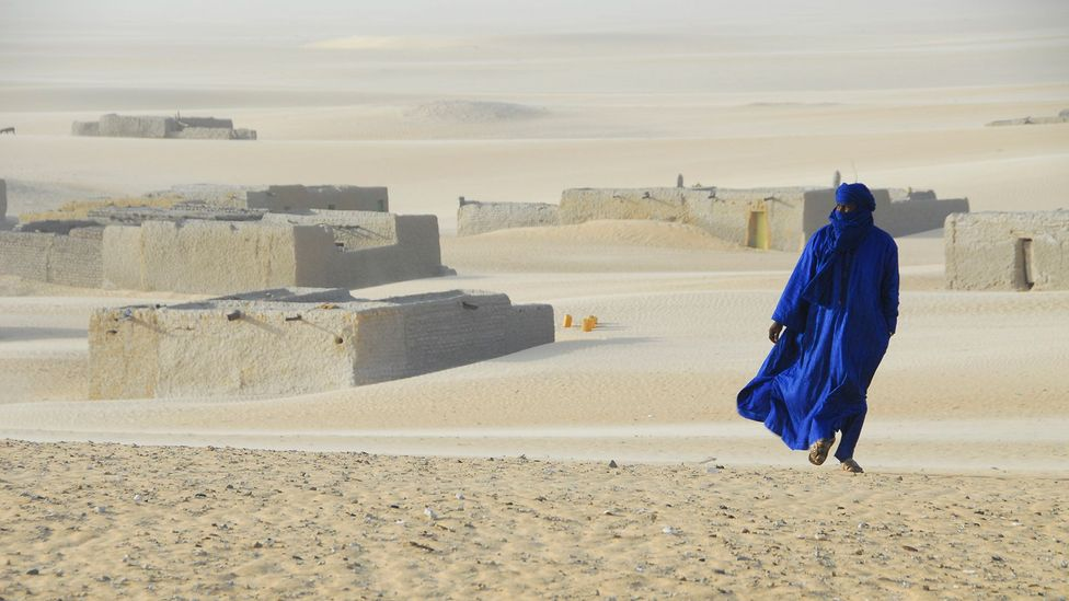 In the deep-desert town of Araouane, many of the buildings have disappeared beneath the surrounding dunes (Credit: Anthony Ham)
