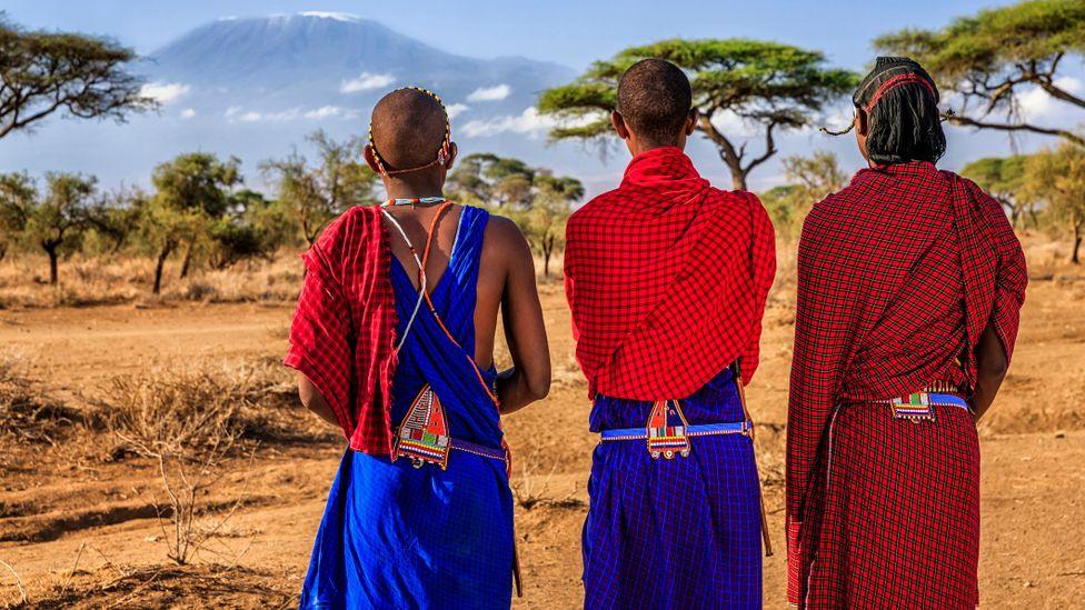 Maasai tribesmen with Mount Kilimanjaro on the background, Kenya