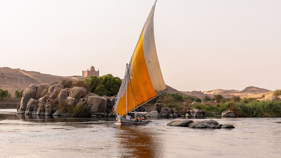 Sailboats pass over the shimmering Nile river (Credit: Mai Farouk)