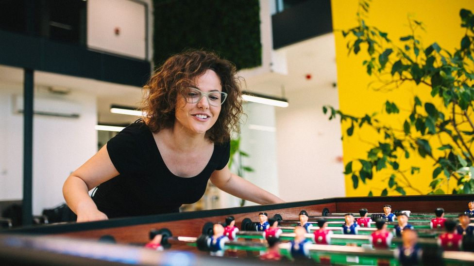An office worker playing table football