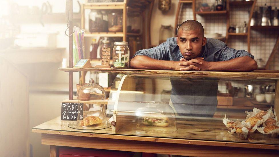Demoralised man in cafe