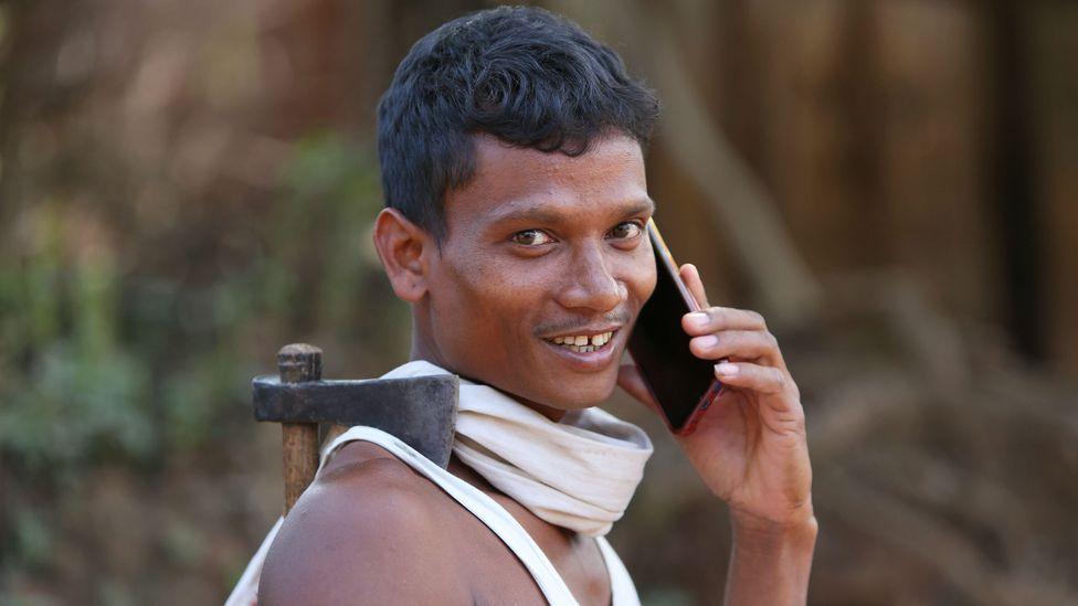A tribal farmer on the phone in Lanjigadh village, Odisha, India (Credit: Alamy)