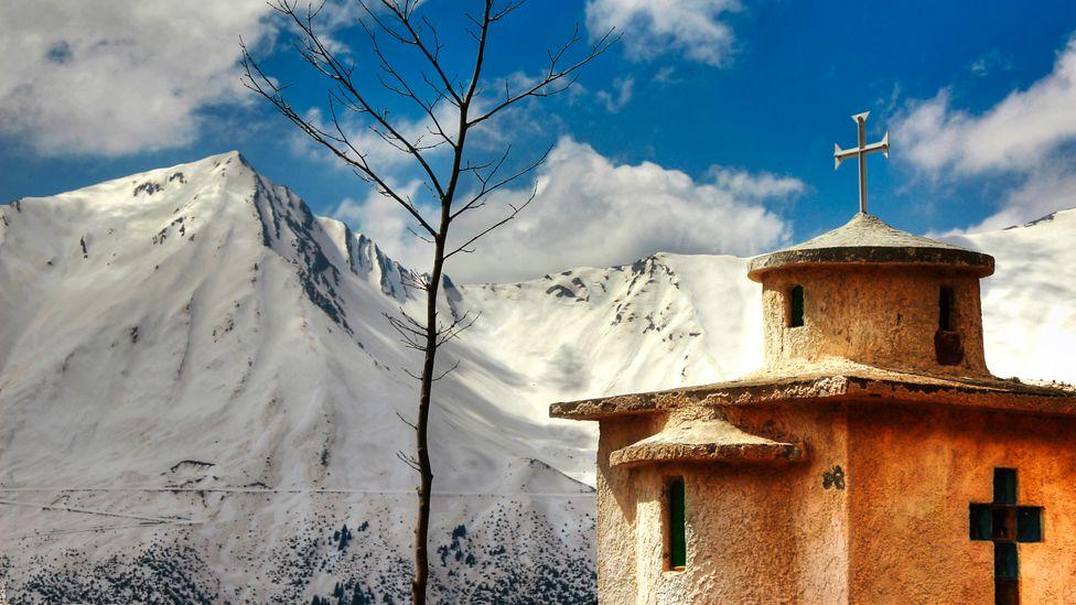 Church and snowy mountain view at Agrafa, Greece
