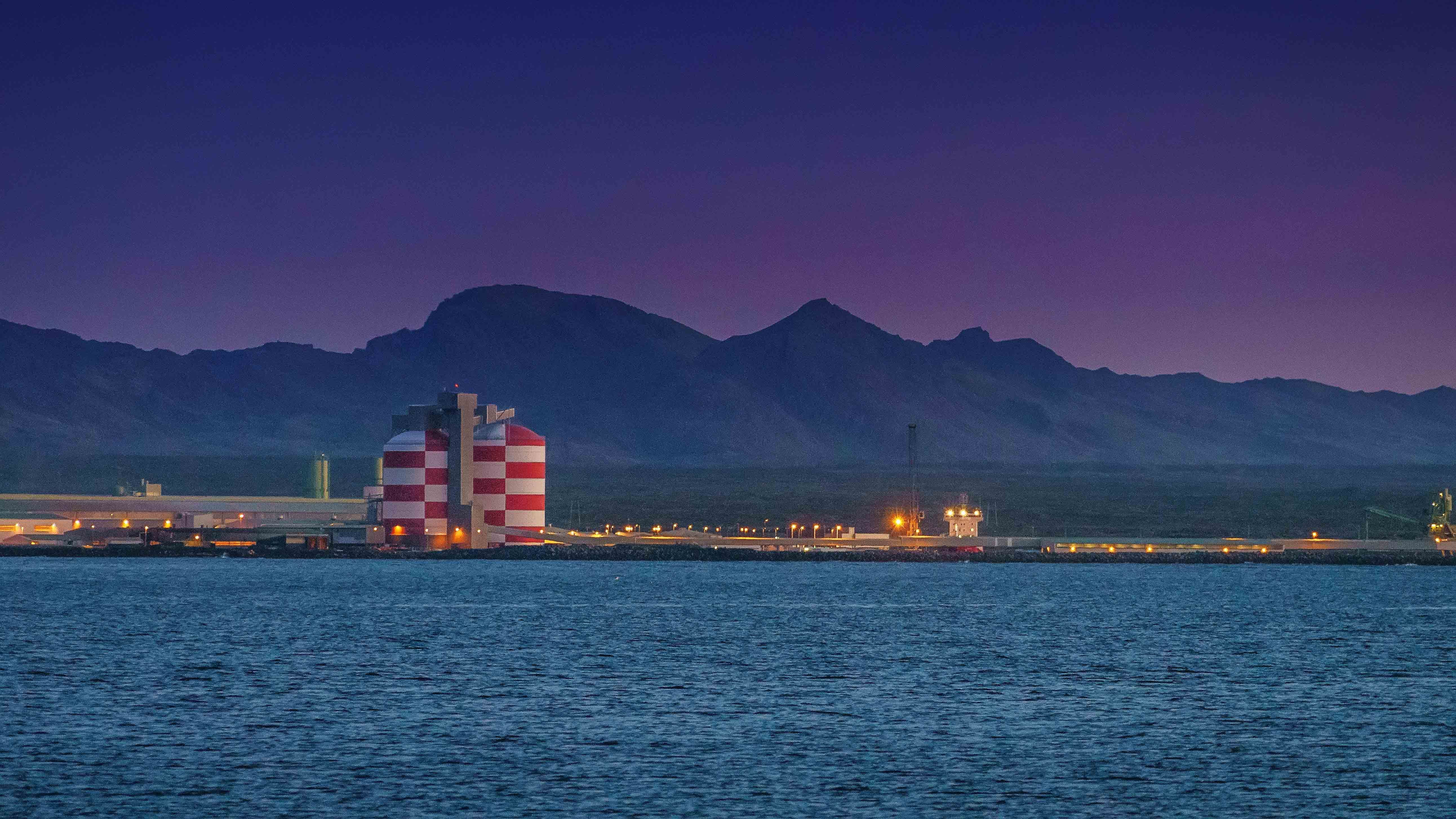 The red and white towers of the aluminium smelting facility at Straumsvík, Iceland are a local landmark (Credit: Alamy)