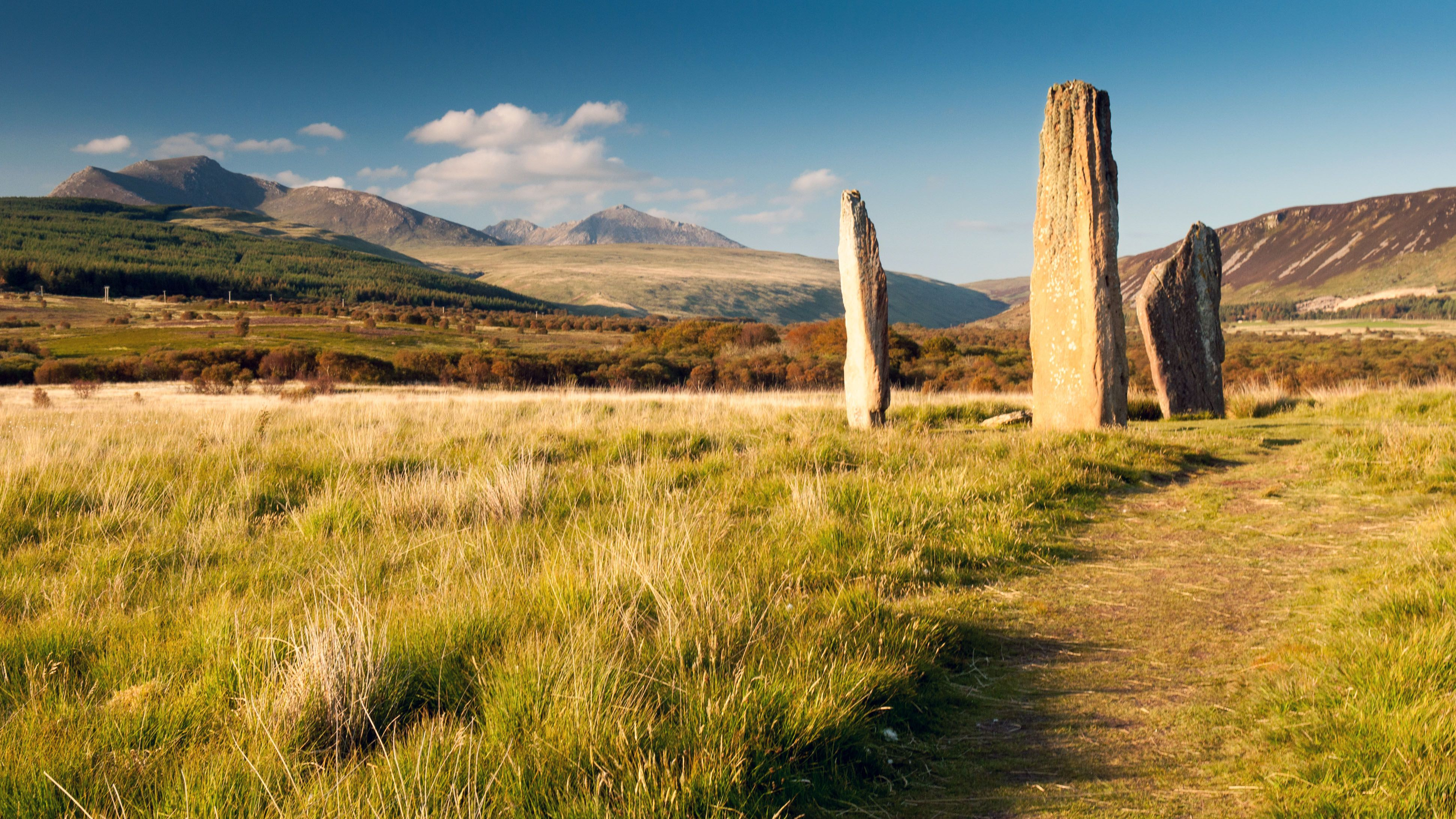 Documented human activity on the Isle of Arran dates as far back as 10,000 years, including these Bronze Age stone circles (Credit: Joe Dunckley/Getty Images)