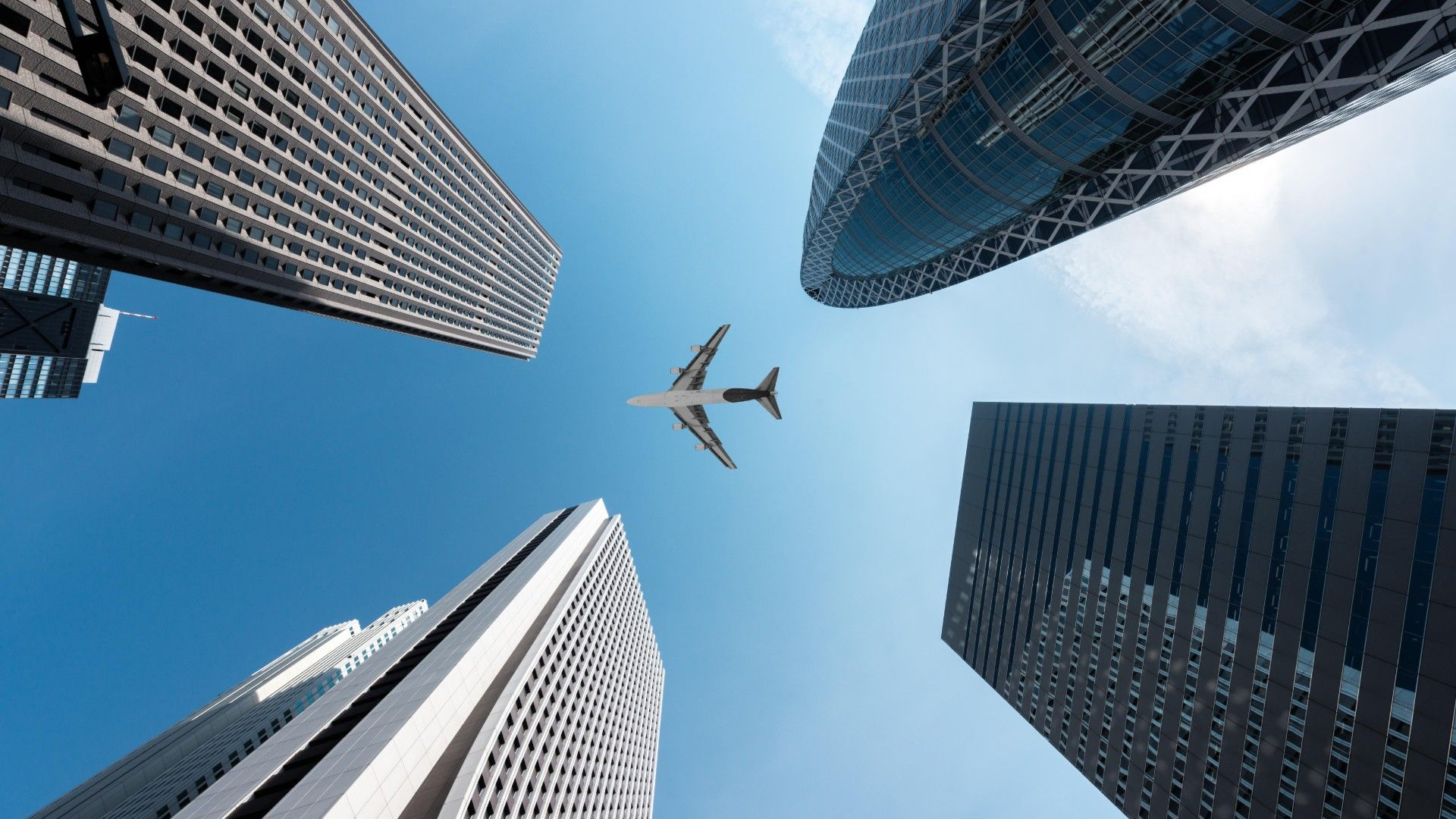 File image of a plane flying over skyscrapers