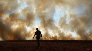 Wildfires can release huge amounts of greenhouse gases and harmful smoke particles that affect human health (Credit: AFP/Getty Images)