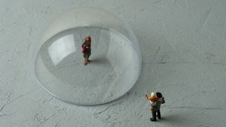 Toy figure in plastic bubble (Credit: Hamzaturkkol/Getty Images)