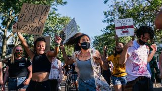 Three Black Lives Matter supporters take to the streets (Credit: Getty Images)