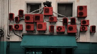Air-conditioning units on a wall (Credit: Javier Hirschfeld/ Getty Images)