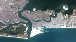 The majority of Lagos, Nigeria, is no more than a few metres above sea level, and at risk of coastal erosion (Credit: Alamy)