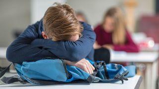 Teen sleeping in class (Credit: Westend61/Zerocreatives/Getty Images)