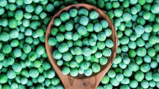 Frozen peas on spoon (Credit: Getty Images)