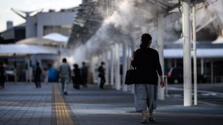 The authorities in Tokyo have installed misting stations and shelters that produce a fine spray of cooling water onto passing pedestrians (Credit: Matthias Hangst/Getty Images)